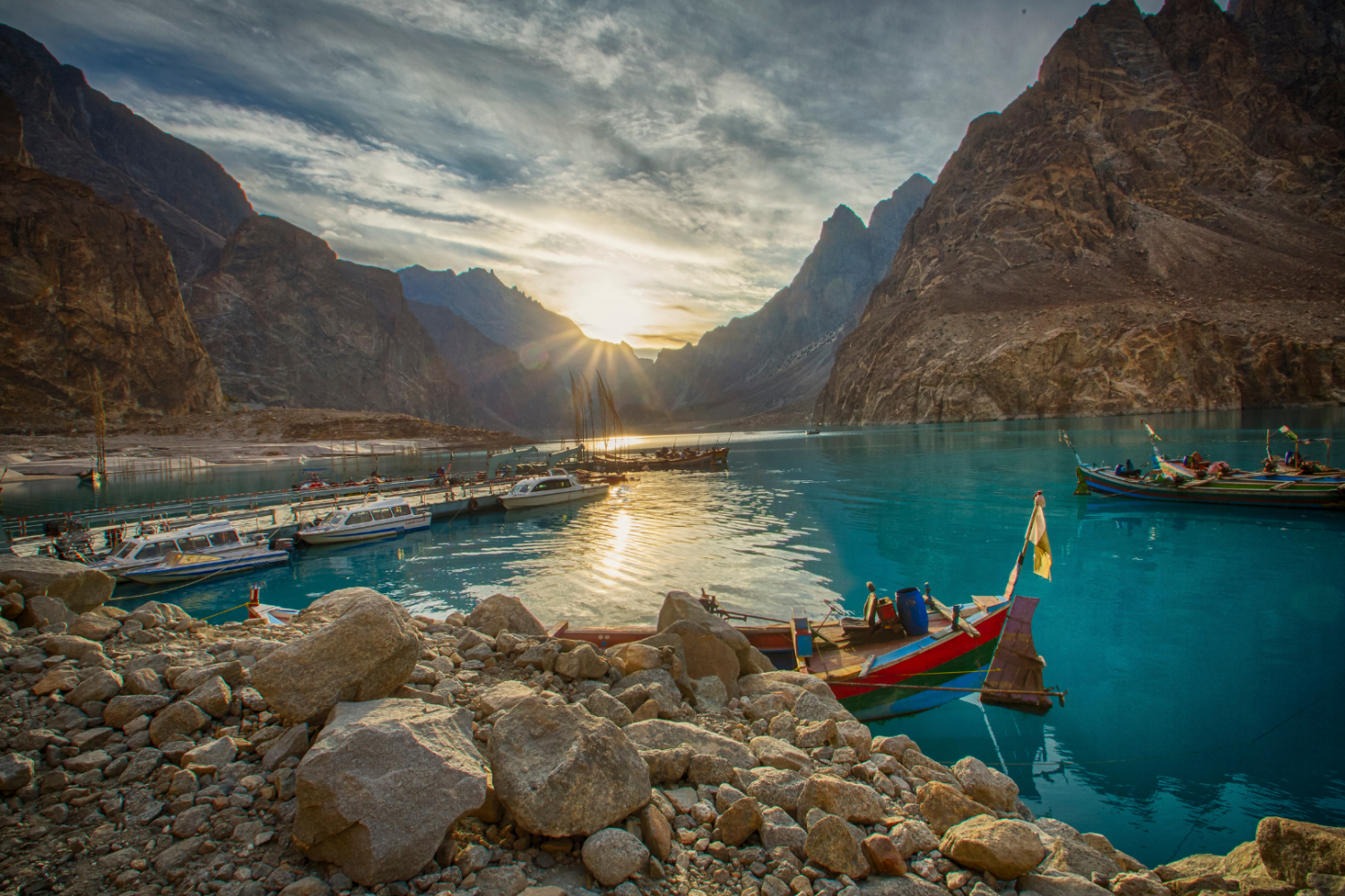 attabad lake in summer with boats - rozefstourism.com