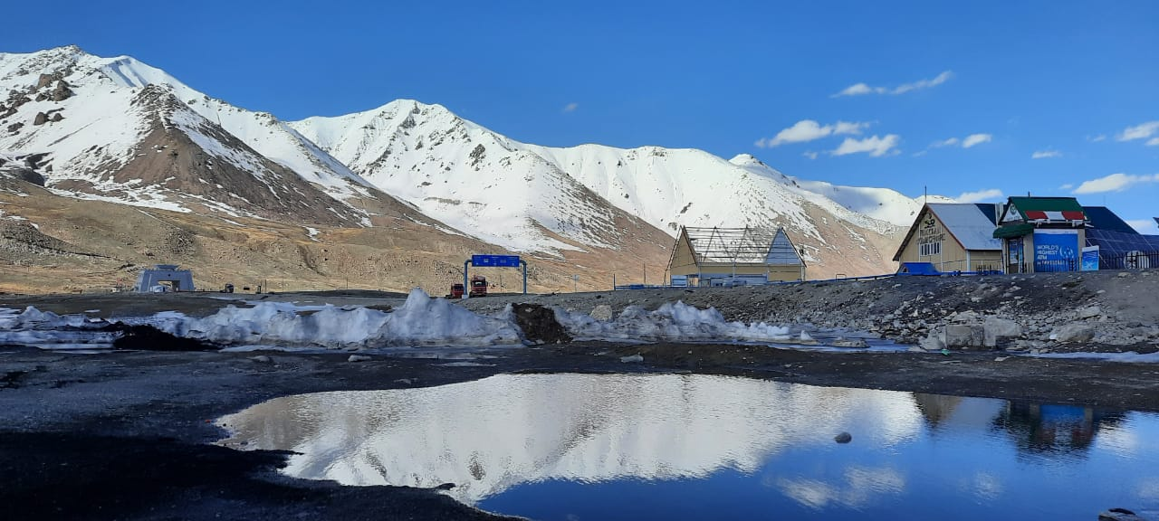 Khunjerab Pass with Snow covered Mountains and their reflection in mini lake