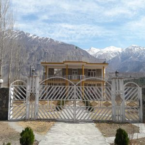 Hotel in Nanga Parbat near Fairy Meadows with Lush Green Mountain in the Background - Rozefs Tourism