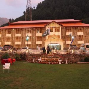 Hotel in Naran Valley with Lush Green Mountains in the Background