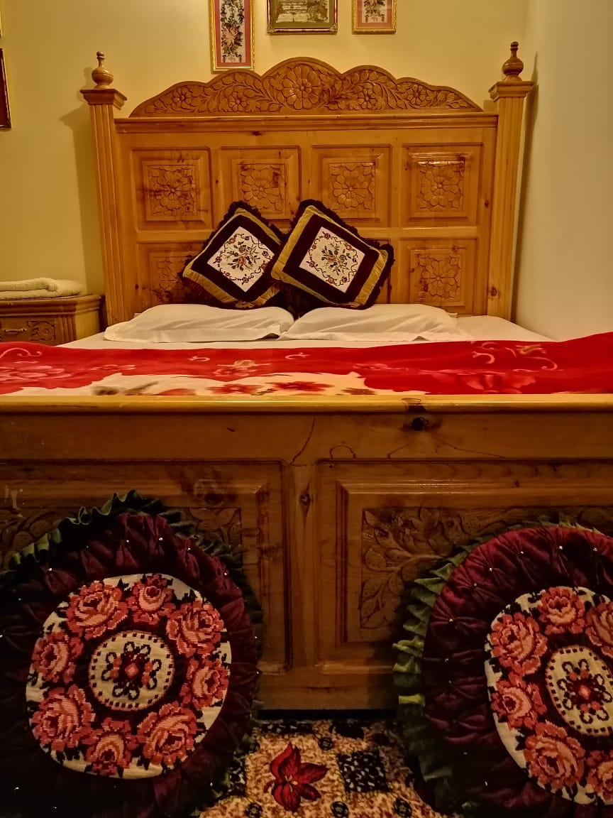 Double bed in luxury room of hotel in hunza
