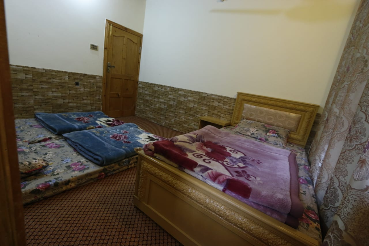 Double bed room with extra beds in hotel in hunza valley