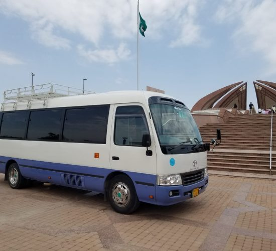 Rozefs Tourism with Tourists in Islamabad at Pakistan Monument in Toyota Coaster