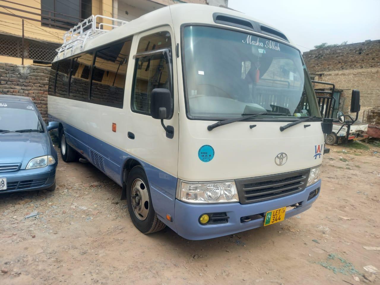 Toyota Coaster bus ready for Hunza tour - Rozefs Tourism
