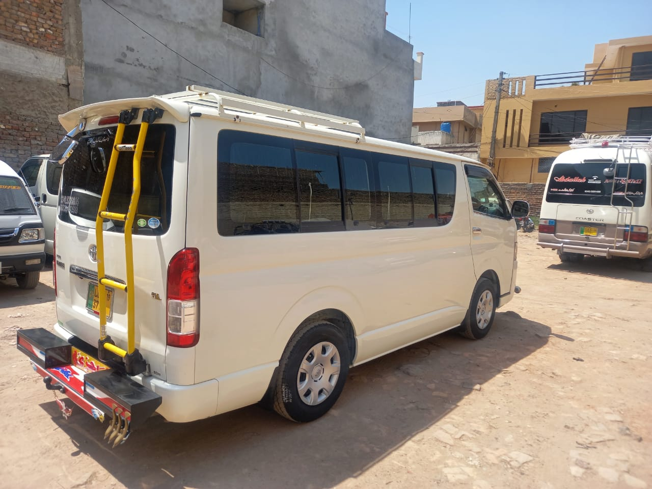 Toyota Hiace White Color with Toyota Coaster - Rozefs tourism