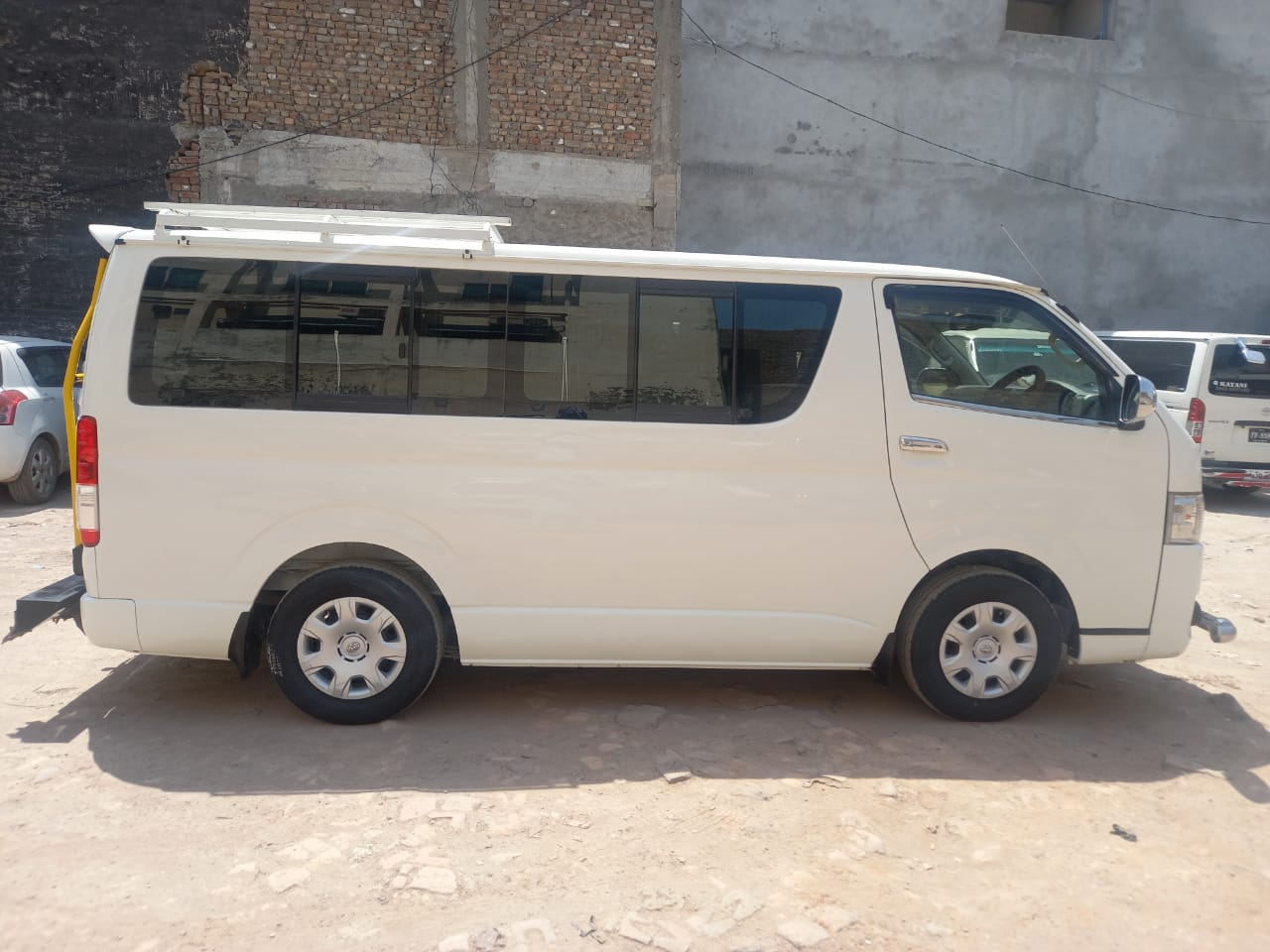 Toyota Hiace White color - Rozefs Tourism