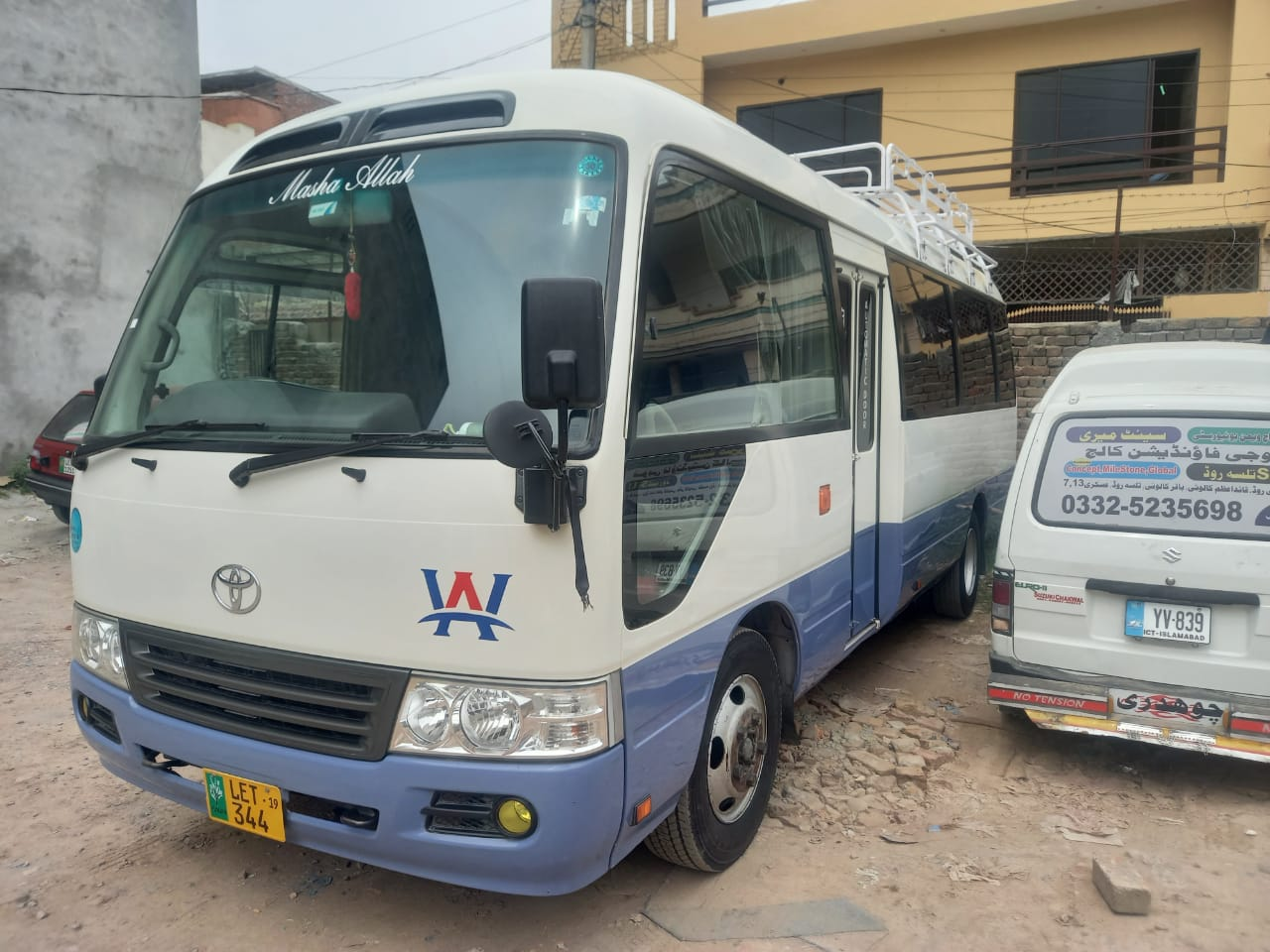 Toyota coaster bus ready for khunjerab tour and for stay in hotel in huzna with tourists