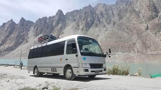 Toyotal Coaster bus at Attabad Lake with Rozefs Tourism tourists