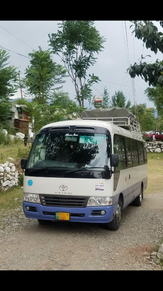 Toyotal Coaster bus in Islamabad with Rozefs Tourism