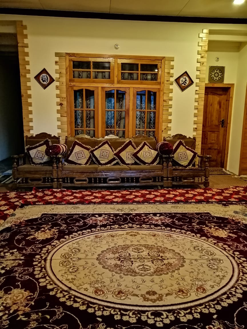 hall of hotel in hunza with chairs