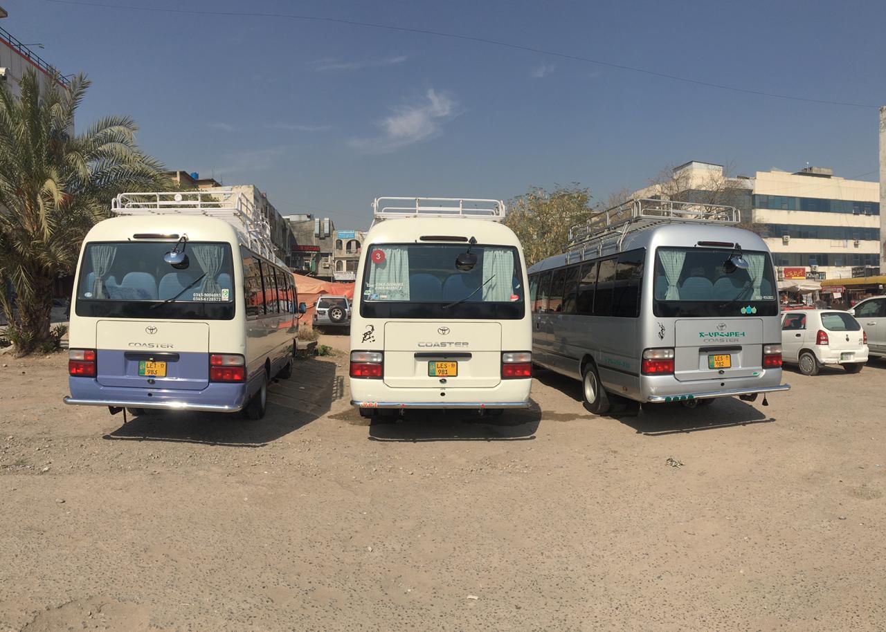 Three toyota coasters bus ready for tours - Rozefs Tourism