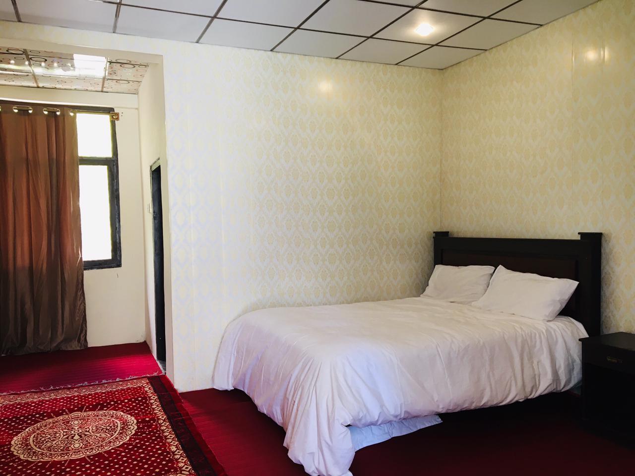 double bed room of hotel in passu