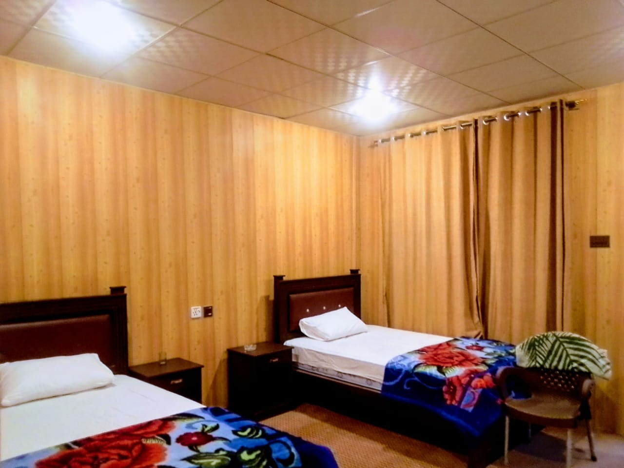 hotel room in Passu with two beds