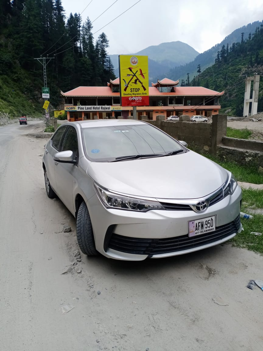 White Silver Black Toyota Corolla available for rent in Islamabad and Hunza Gilgit for Hunza valley tour