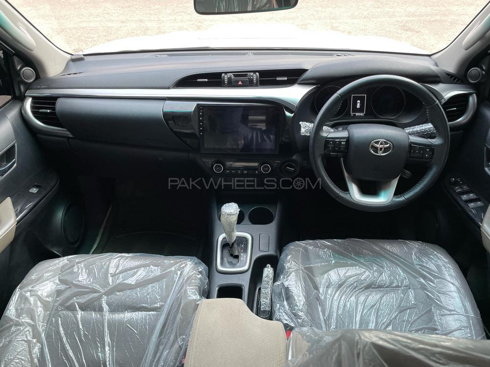 interior of white hilux 4x4 car available for rent in islamabad and gilgit hunza