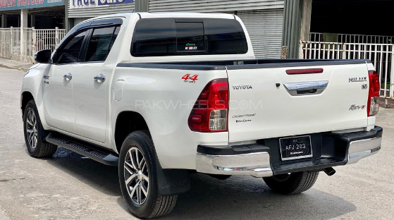 white hilux 4x4 car for rent in islamabad and gilgit back side picture.png